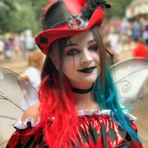A Harley Quinn riding hat puts a spin on this Renaissance fairy look.