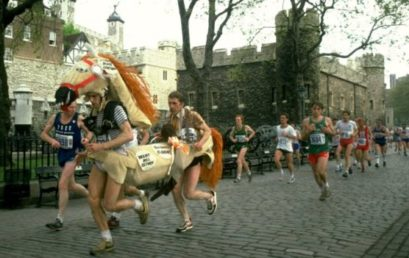 A pantomime horse runs past the Tower of London during 1982's London Marathon (Image: Getty Images)